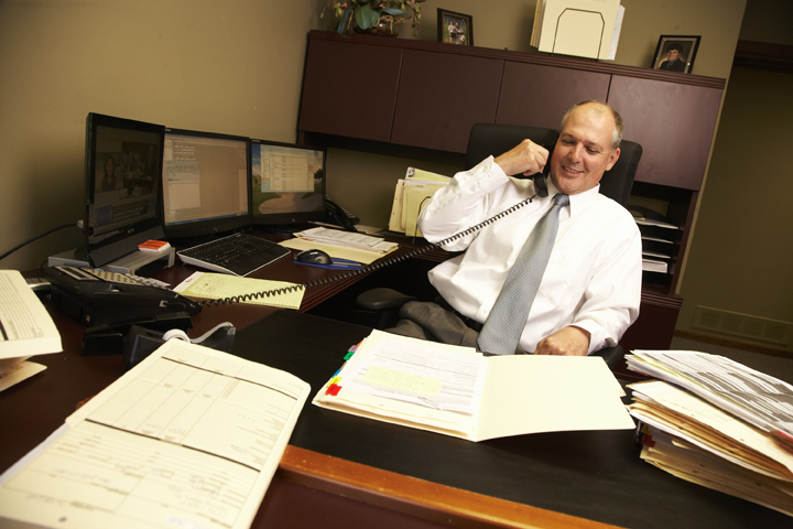 alan helping clients with their mortgage loans